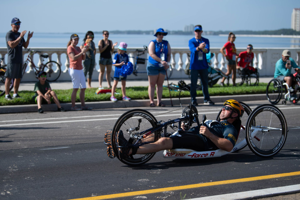 190623-N-RL695-1161 TAMPA, Fla. (June 23, 2019)- A member of Team Navy cycling team participates in a time trial as part of 2019 Department of Defense Warrior Games in Tampa, Florida, June 23. Team Navy is comprised of athletes from Navy Wounded Warrior-Safe Harbor, the Navy's sole organization for coordinating the non-medical care of seriously wounded, ill and injured Sailors and Coast Guardsmen, providing resources and support to their families. (U.S. Navy photo by Mass Communication Specialist 3rd Class Marianne Guemo/Released)