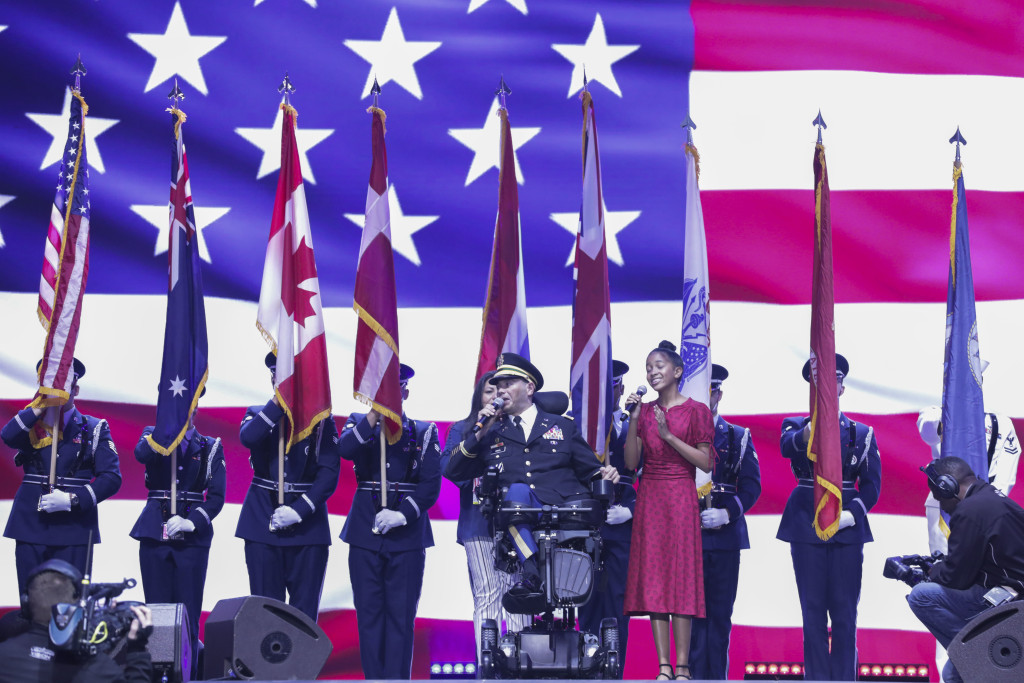 U.S. Army Capt. Luis Avilal songs the National Anthem June 30, 2019 at the Amalie Arena in Tampa, FL. The Department of Defense Warrior Games are conducted June 21-20, hosted by Special Operations Command, Tampa, Florida. It is an adaptive sport competition for wounded, ill, and injured service members and veterans. Approximately 300 athletes representing teams from Army, Marine Corps, Navy, Air Force, Special Operations Command, United Kingdom Armed Forces, Australian Defense Force, Canadian Armed Forces, Armed Forces of the Netherlands, and the Danish Armed Forces will compete in archery, cycling, shooting, sitting volleyball, swimming, track, field, wheelchair basketball, indoor rowing, powerlifting, and for the first time in Warrior Games history, golf, wheelchair tennis, and wheelchair rugby. (U.S. Army Photo by Spc. Evens Milcette Jr.)