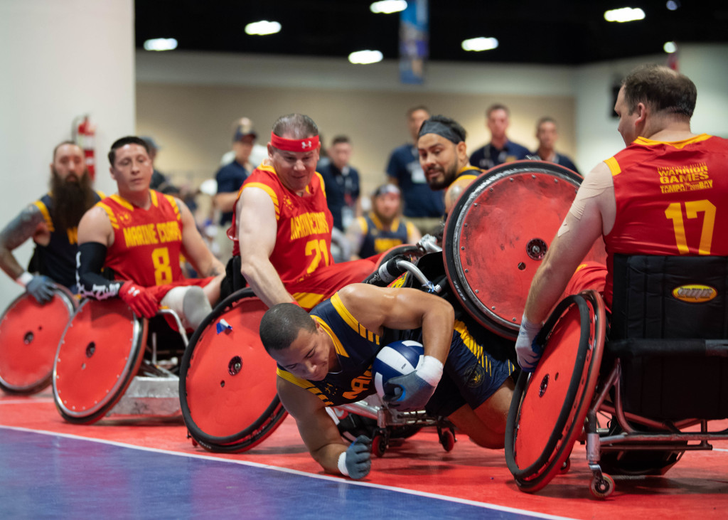 190627-N-RL695-2275 TAMPA, Fla. (June 27, 2019) Aviation Boatswain's Mate 3rd Class Dakota Hollingsworth participates in a wheelchair rugby match for Team Navy against Team Marine Corps during the 2019 Department of Defense (DoD) Warrior Games at the Tampa Convention Center, June 27. Team Navy is comprised of athletes from Navy Wounded Warrior-Safe Harbor, the Navy's sole organization for coordinating the non-medical care of seriously wounded, ill and injured Sailors and Coast Guardsmen, providing resources and support to their families. (U.S. Navy photo by Mass Communication Specialist 3rd Class Marianne Guemo/Released)